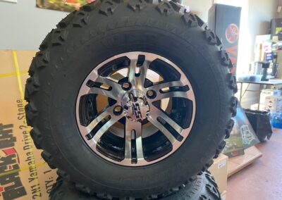 10″ LOLO Machined/Black wheels with All Terrain Tires.