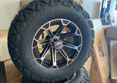 12″ Vinny Mahined/Black Wheels with 23×10.5-12 All-Terrain Tires